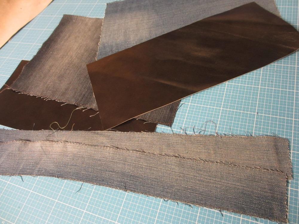 Alte Jeanshose zerschnitten und Leder zugeschnitten für die Tasche