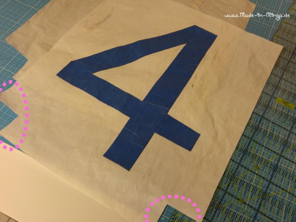 aus dem rechteckigen Stück Stoff werden unten Ecken rausgeschnitten - made-in-minga.de